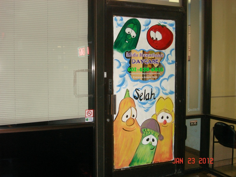 The remodeled entrance door with Veggie Tales characters AFTER